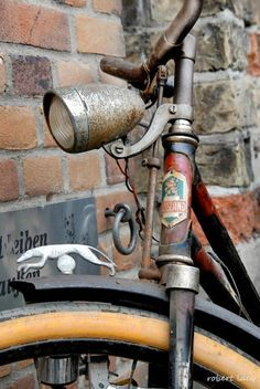 Saw this old bicycle leaning against a wall in Flensburg, Germany, begging to be photographed. GREYHOUND BICYCLE.
