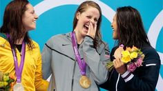 Silver medallist Emily Seebohm of Australia, gold medallist Missy Franklin of the United States and bronze medallist Aya Terakawa of Japan celebrate with their medals during the Victory Ceremony for the women's 100m Backstroke on Day 3 of the London 2012 Olympic Games.