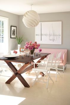 Contemporary Dining Room with pink sofa