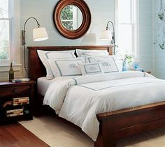 Love the dark wood with white monogrammed linens