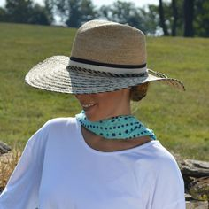 Classic, wide-brim fedora hat with stylish stripes woven into the brim; fall in love with the vintage drama of a trend-forward floppy hat this summer.        Twisted braided bow and double ribbon band, complete with adjustable sweatband for the perfect fi