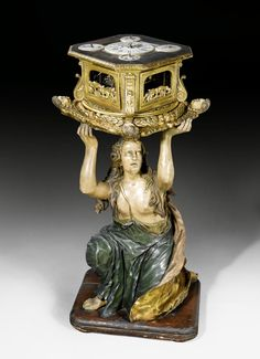 FIGURE CARRYING LARGE CLOCKWORK, early Baroque, the movement signed CYPRIANUS REUTER A AUGSBURG (Cypran Reuter, active in Augsburg circa 1620), Augsburg circa 1620/30.