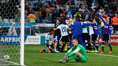 Argentina celebrating and Cillessen reacts