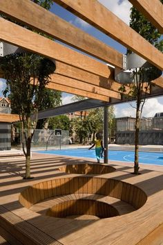 redefine a public space - trees penetrate shading trellis and cozy outdoor seating
