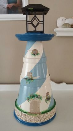 TeRRa CoTTa LiGHTHouSe Clay Pot Projects, Clay Pot Crafts, Diy Clay, Flower Pot Art, Flower Pot Crafts, Flower Pots, Diy Arts And Crafts, Diy Crafts, Clay Pot Lighthouse