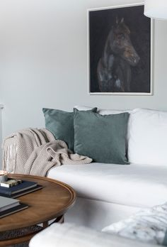 Sarah Gibson of Room for Tuesday's stylish living room Chandelier In Living Room, My Living Room, Home And Living, Living Room Decor, Green Cushions, Velvet Cushions, Cushions On Sofa, Round Wooden Coffee Table, White Sofas