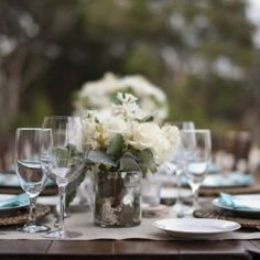 An organic and rustic reception table setting with pops of french blue.