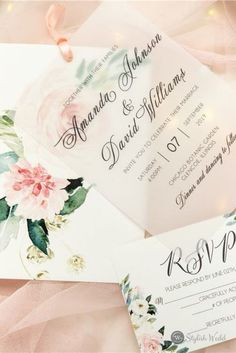 This pink floral wedding invitation brings to mind soft florals, joy, and love – all things you're hoping for on your big day! The layered design with a vellum paper on top is a new trend now!