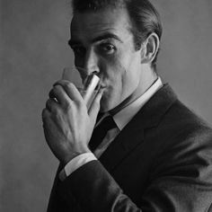 Sean Connery drinking from a glass during a photoshoot for Smirnoff Vodka, 1st January 1962.Photo by Terence Donovan