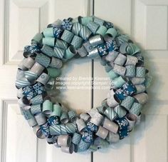 Step-by-step tutorial at http://www.keenankreations.com/2013/10/curled-paper-wreath-tutorial.html
