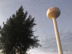 A water tower on the west side of town presents a contrast to the autumn sky.