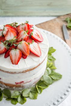 lemon curd cake with lemon cream cheese frosting & strawberry jam.