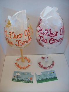 Personalized Mother of the Bride and Mother of the Groom wine glasses with yellow flowers and red flowers. http://www.facebook.com/buggybeandesigns