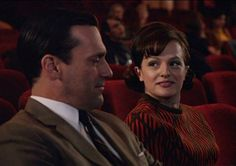 Don and Peggy share a moment in a darkened theater, Season 5, Ep. 13