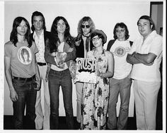 "Rush was still a local band, when Donna Halpert, in front holding album, played ""Working Man"" on a Cleveland radio station."