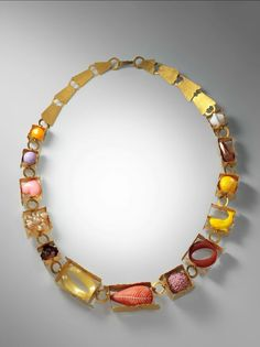 """Helen Britton, """"Boxes and Components"""" Necklace (2010) Gold plated silver, plastic polymer, and found objects, 20 in. (50.8 cm), The Metropolitan Museum of Art, Gift of Donna Schneier, 2013 (2013.602.5).:"""