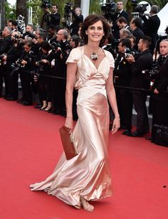 A lesson in how ageless French ingenues always dominate the Cannes red carpet. I love her material, not her fit....but the article says to FEEL GOOD in what you wear!