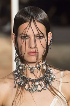 Make-up at Alexander McQueen, by Lucia Pieroni, comprised wet-look skin and smudgy eyeliner.