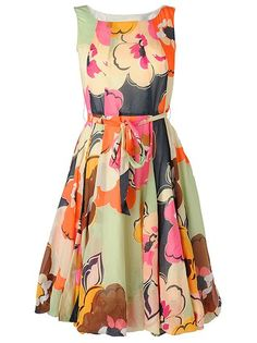 Can't you just imagine a tea party?  This dress, some lovely slip of a sandal and the bright sun.  Perhaps, even a Pimms!