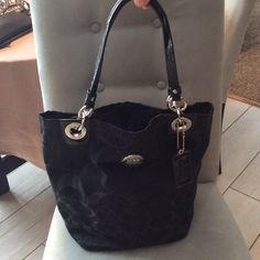 Authentic Coach Signature Canvas Hobo Very Gently used condition.  Outside and inside pockets.  Inside zipper also.  Exterior in very good condition, interior too, but some pen marks. Coach Bags Shoulder Bags