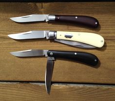 Bose Knives - On top is a 3.25 single blade trapper with old burgundy micarta. Serial #1. On the bottom is a shadow wharncliffe trapper also 3.25 . Serial #4. In the middle is the more common 3.5 WT. All by Reese. In by experience nobody makes small slip joints like Reese Bose.