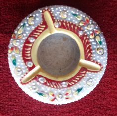 It is a marble ashtrays. Immaculate marble is embellished with designs and polished to create a smooth desirable look. Known for quality and