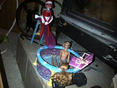 Pool party by the fireplace...Suzy borrowed a bikini top and sunglasses from Barbie. Elf on the shelf