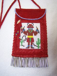 Native American handmade red leather beaded bag by TrackthePony, $125.00