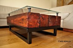 Beautiful hand-made table with dimensions of 90x57x36. TIG welded construction, the color of dark steel given by oxidation. Pine beam oiled, many years of seasoning to make them so special and show the regular appearance of old wood. Stands holding the glass top done on a lathe and then covered with oxidative. Inside of stands is a special insert of cork and rubber to prevent slipping of the glas top. The product truly unique and durable.
