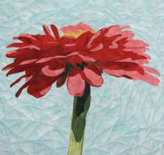 Title: Red Zinnia  Medium: Art Quilt  Dimensions: 18 x 23 bound      In making this quilt I used the raw edge applique technique. Embroidered