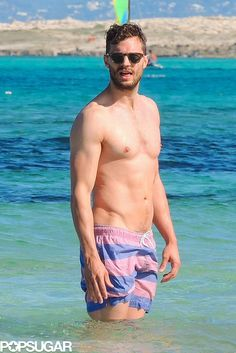 Shirtless Jamie Dornan Crawling on the Sand Is Sort of Everything