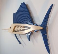 The Sailfish is large.... 72 long x 27 high x 2 1/2 thick. Each sculpture is constructed of 2 layers of 3/4 birch plywood and 1 layer of 1/2. After the pieces are rough cut, the layers are laminated together and shaped to their final contour. The 3/4 ply wood is 13 layers of solid birch and 1/2 is 9 layers totaling 35 layers. This makes the material stable and the quality birch allows for an exceptional finish with acrylic washes and lacquer.  The included hanger allows the piece to float…