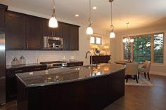 Preston Home - large flat granite counter in kitchen with dark tones Granite Counters, Preston, Kitchen Island, Houses, Flat, Dark, Home Decor, Island Kitchen, Homes