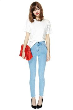 Minimal casual chic. White slouchy tee, high waist light wash skinnies, black pointed pumps, statement necklace, red clutch, red lips and messy bob and blunt bangs.