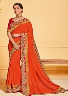 Stunning Orange Color Poly Silk Party Wear Saree Product Details : Saree color is orange. Fabric of this designer saree is poly silk. Comes along with raw silk unstitched blouse. Saree has lace border. Ideal for wedding function, party function, fe Trendy Sarees, Stylish Sarees, Raw Silk Saree, Pure Silk Sarees, Party Fashion, Fashion Outfits, Orange Saree, Work Sarees, Traditional Sarees
