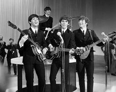 The Beatles were playing songs. Read more about the Beatles here at beatlesfansunite.com. Join for free and vote for your favorite Beatles.
