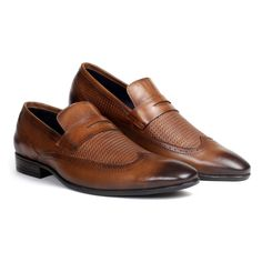 #PierreCardin presents a unique #wing-tipped slip-on. Crafted with textured velvet crust #leather, this #slipon is a stunning culmination of detail and form. With a #handmade #sole and a burnished tip, this shoe is ideal for your next board meeting. #slipon #cognac #halfstrap #formal #shoe #classy #stylish #mensfashion #stylish #wingtip #texture #shoponline #menfashion #menstyle #businesscasual #cognac #tan #formalbrown #b