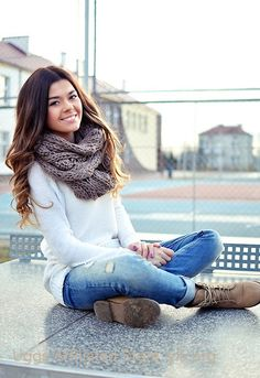 White chunky sweater, thick cozy scarf, ragged skinnies.