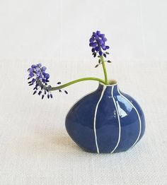 Simple, classic round bud vase in Danish blue with thin, raised white stripes. Who's ready for spring and summer?!