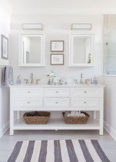 To increase the visual space in a small bathroom, consider white paint and accessories paired with mirrors. This all-white vanity bears mirror-front doors and drawers, which reflect light and also make the bathroom feel larger. Contemporary hardware and a vessel sink prevent the mirrored surfaces from looking outdated.