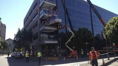 A crane is used to install a monorail carriage into Google's Pyrmont offices.