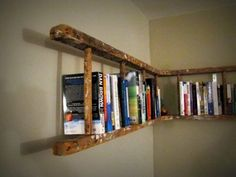 Old wooden ladder turned into book shelf. Old wooden ladder turned into book shelf. Old wooden ladder turned into book shelf. Corner Bookshelves, Ladder Bookshelf, Book Shelves, Diy Ladder, Bookshelf Ideas, Rustic Ladder, Corner Shelf, Creative Bookshelves, Shelving Ideas