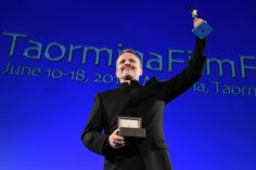 """Miguel Bosé received a Clifton Taormina Limited Edition Watch as the """"Clifton Taormina Award"""". This model has been designed to celebrate the art of film – the 39 mm 18K red gold case is enhanced by the sapphire case back adorned with the festival's logo.  #baumeetmercier #watch #celebratemoments #clifton #limitededition #taorminafilmfest Photo credit: Copyright Notice - 2016 Venturelli Credit - Getty Images for Baume & Mercier"""