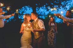 Sparklers at a summer Muskoka wedding by Vaughn Barry Photography www.vaughnbarry.com