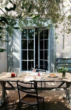 Note folding shutters...could do this with arched french doors!
