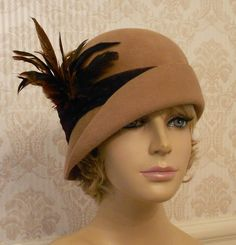 feathered cloche                                                Love this hat!