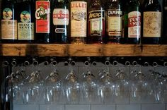 Tubular steel lengths were cut and welded to create a rack for hanging glasses.