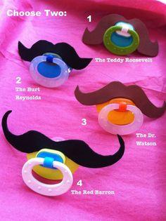 Mustache foam cut-outs on pacifiers:) adorable!