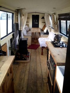 dining table in the very back surrounded by windows, then kitchen, then couches/ beds, then drivers seat 1976 47ft cruiser stern narrowboat