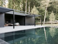 With a pedigree that includes 15 years of working for Belgian master architect Vincent Van Duysen, Marc Merckx designs elegantly minimal furnishings and spaces. A dark, spare pool house has a quiet air of luxury: